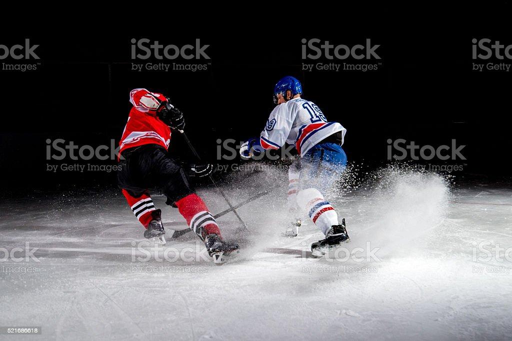 Men playing ice hockey stock photo