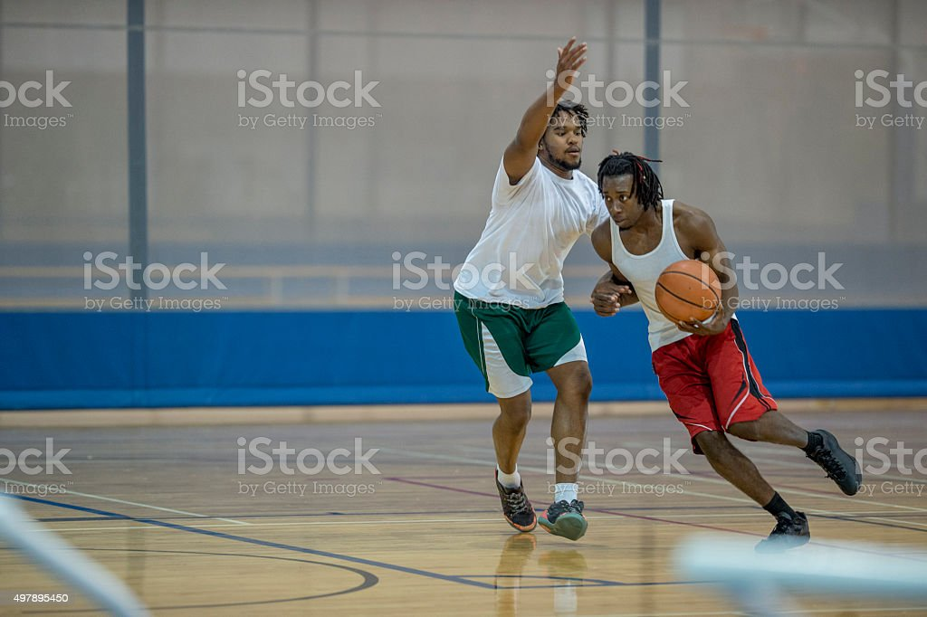 Men Playing One-on-One stock photo