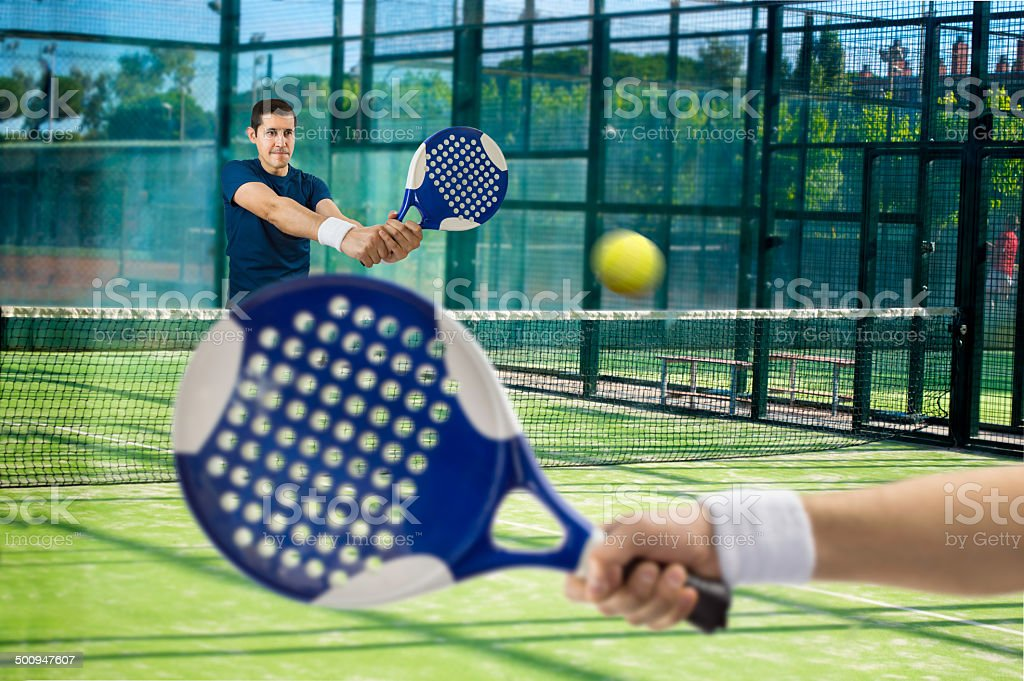 men playing paddle tennis stock photo