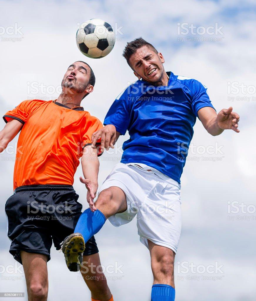 Men playing soccer stock photo
