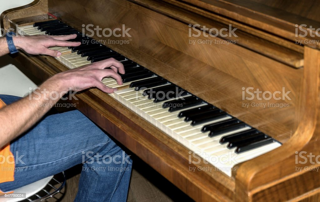 men playing the piano focus for hands stock photo