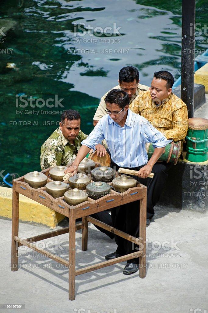 men playing totobuang and tifas stock photo