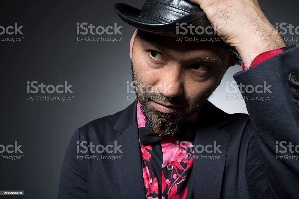 Men plotting bad things while touching the head stock photo