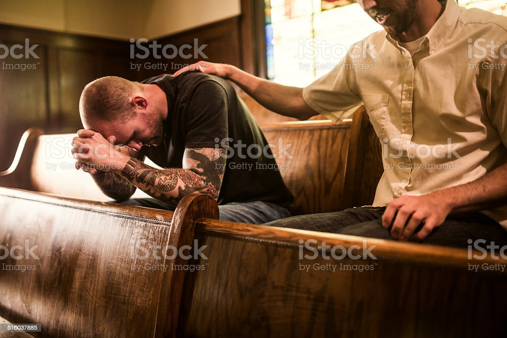 Men Pray Together in Church stock photo