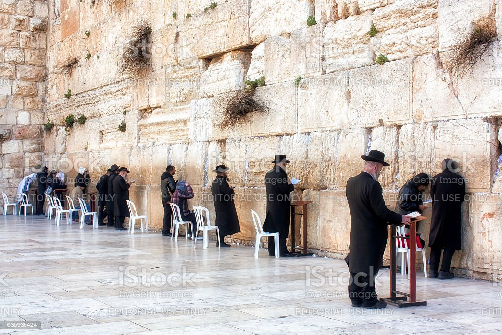 Men Praying at the sacred Wailing Wall. stock photo