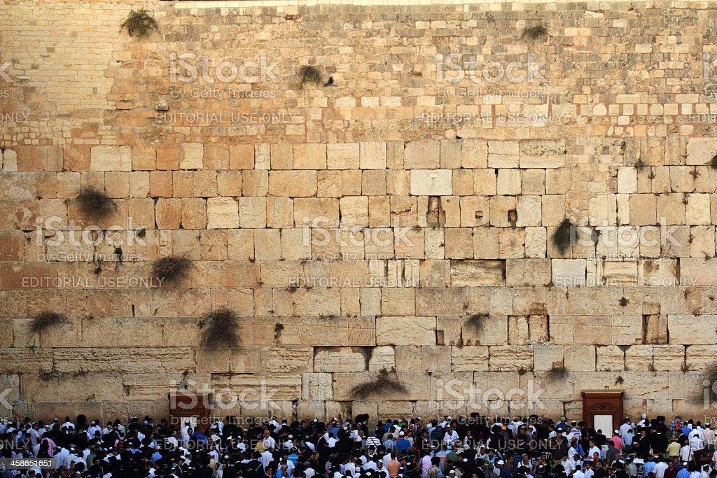 Men praying at the Wailing Wall in Jerusalem royalty-free stock photo