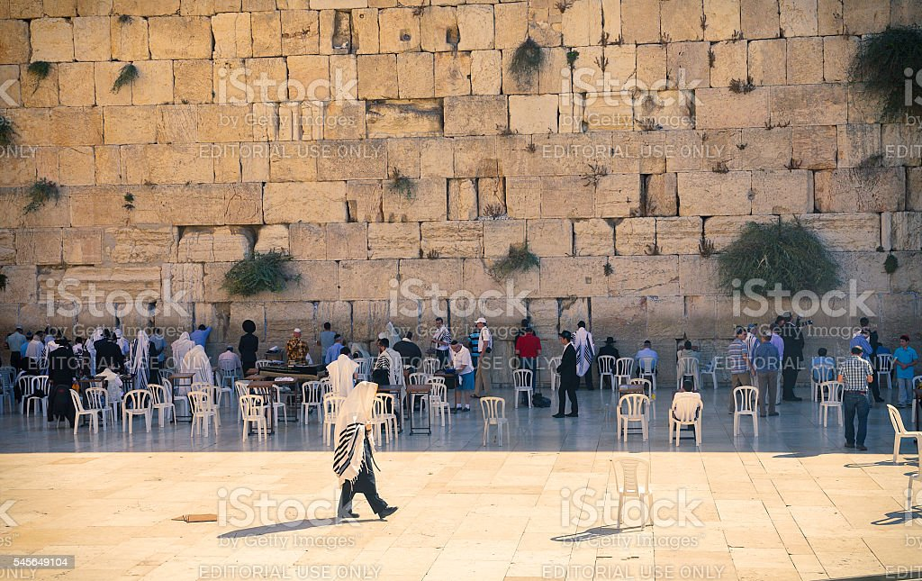 Men praying at the Western wall in Jerusalem, Israel. stock photo