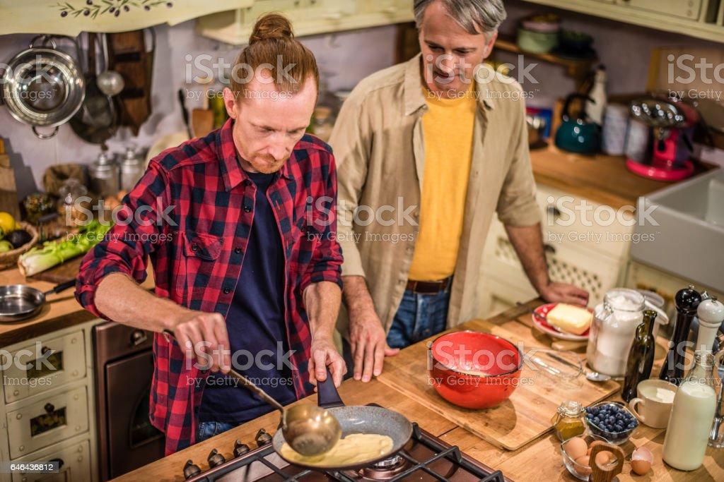Men preparing food stock photo