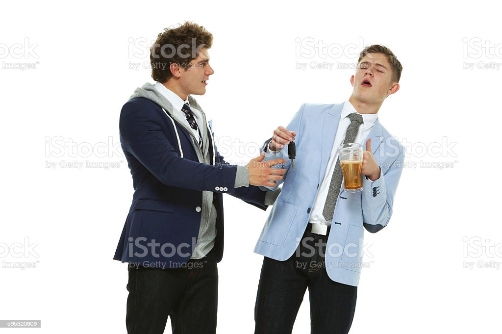 Men preventing his drunk friend from driving stock photo