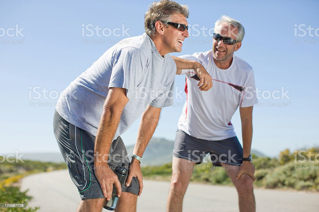 Men relaxing after jogging royalty-free stock photo