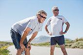 Men relaxing after jogging