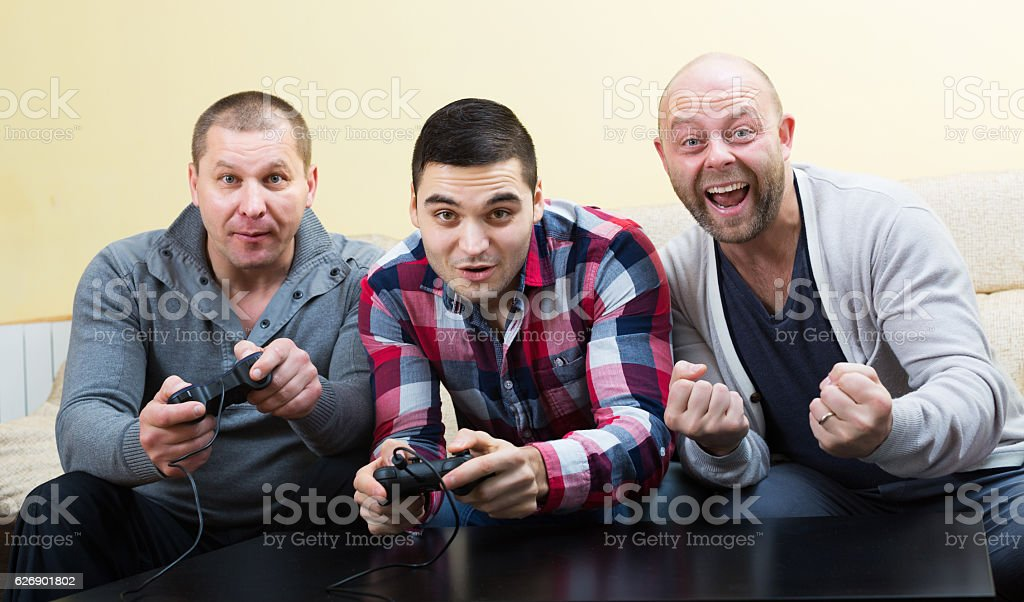 Men relaxing with video game stock photo