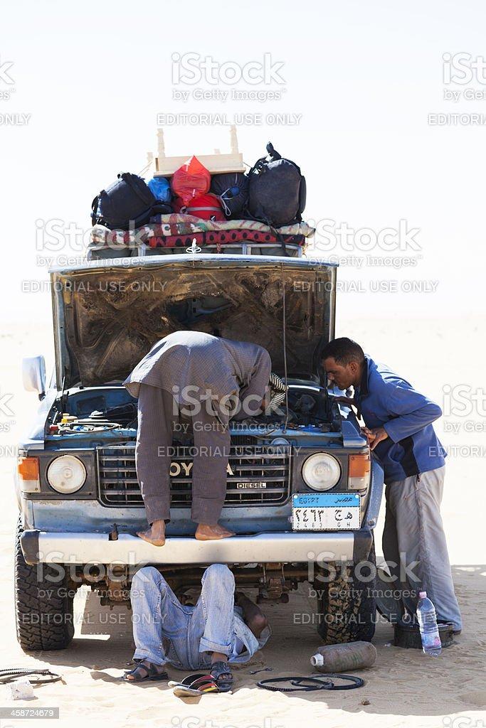 Men repairing a car royalty-free stock photo
