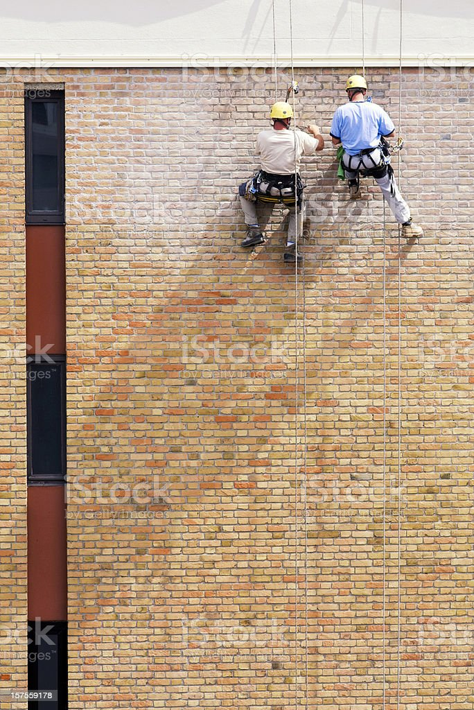 Men restoring the house royalty-free stock photo