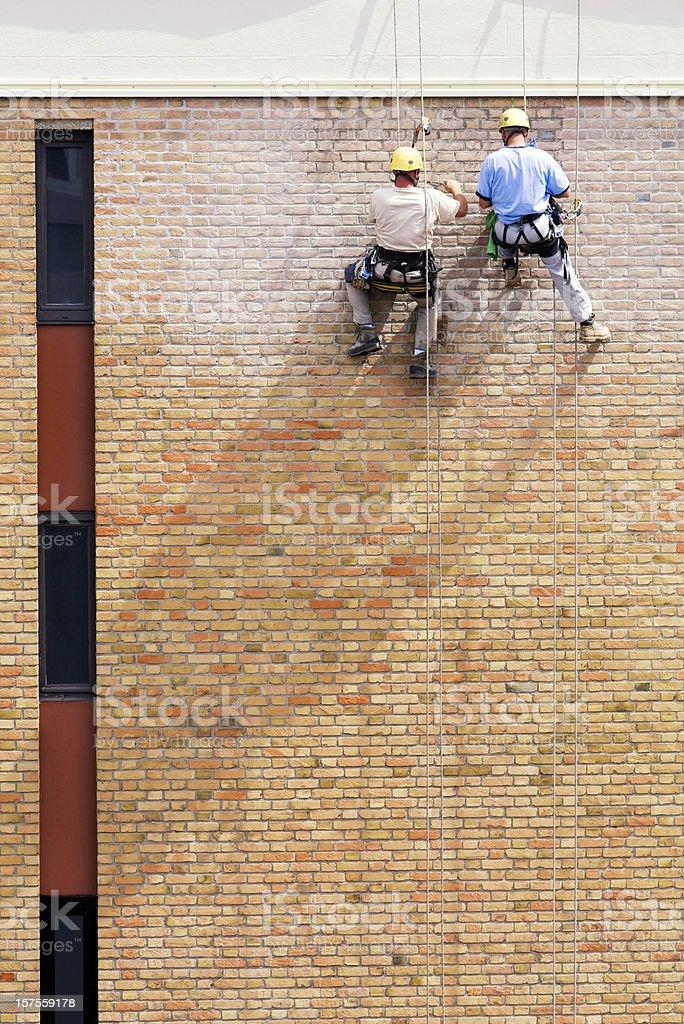 Men restoring the house stock photo