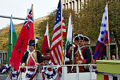 Men Ride In Period Uniforms And Flags