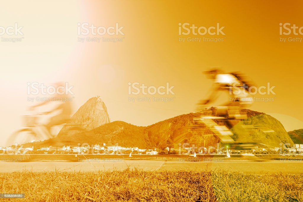 Men riding their bikes in front of the Sugarloaf stock photo