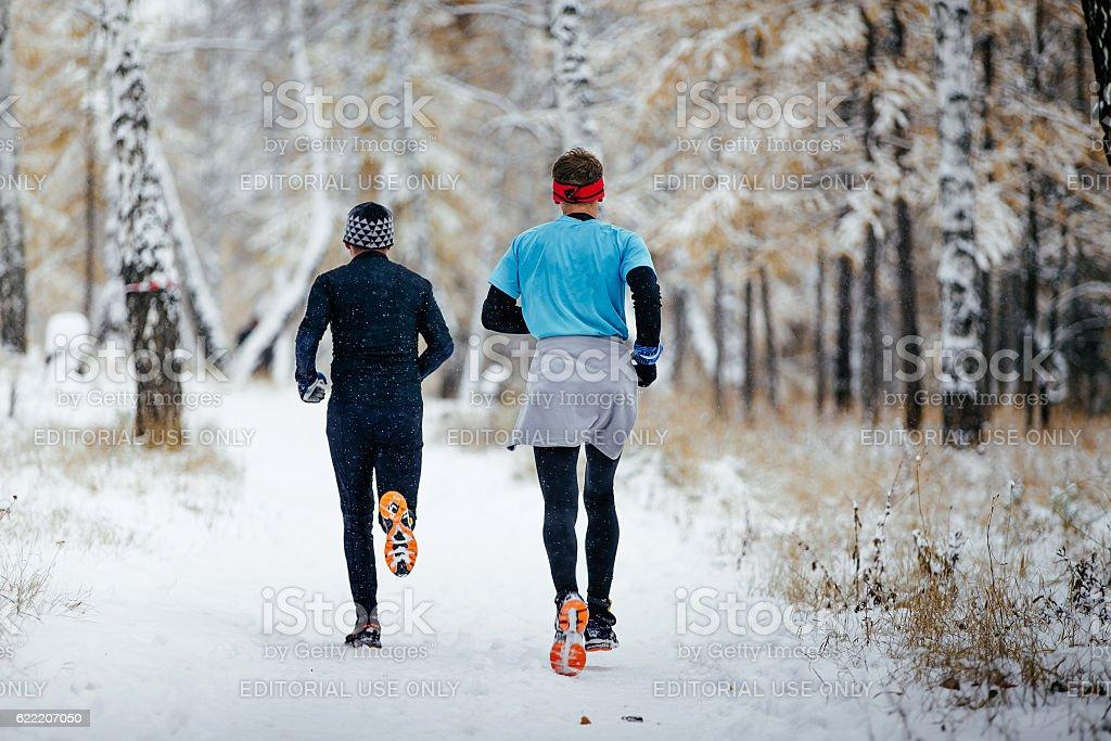 men runners together run stock photo