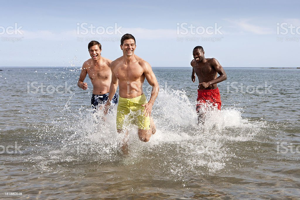 Men Running In The Sea royalty-free stock photo