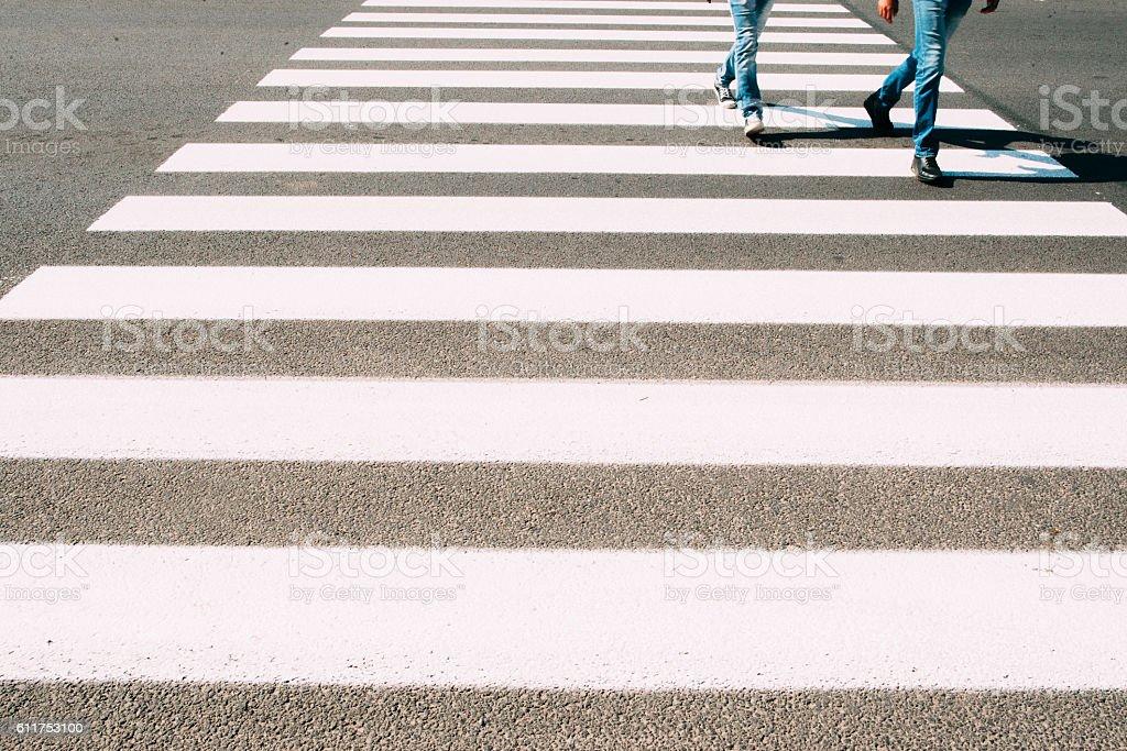 Men running on pedestrian zebra stock photo