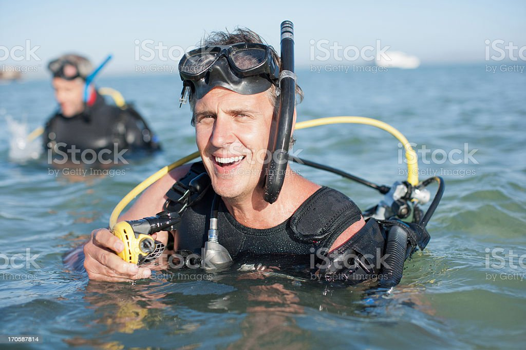 Men scuba gear in water stock photo