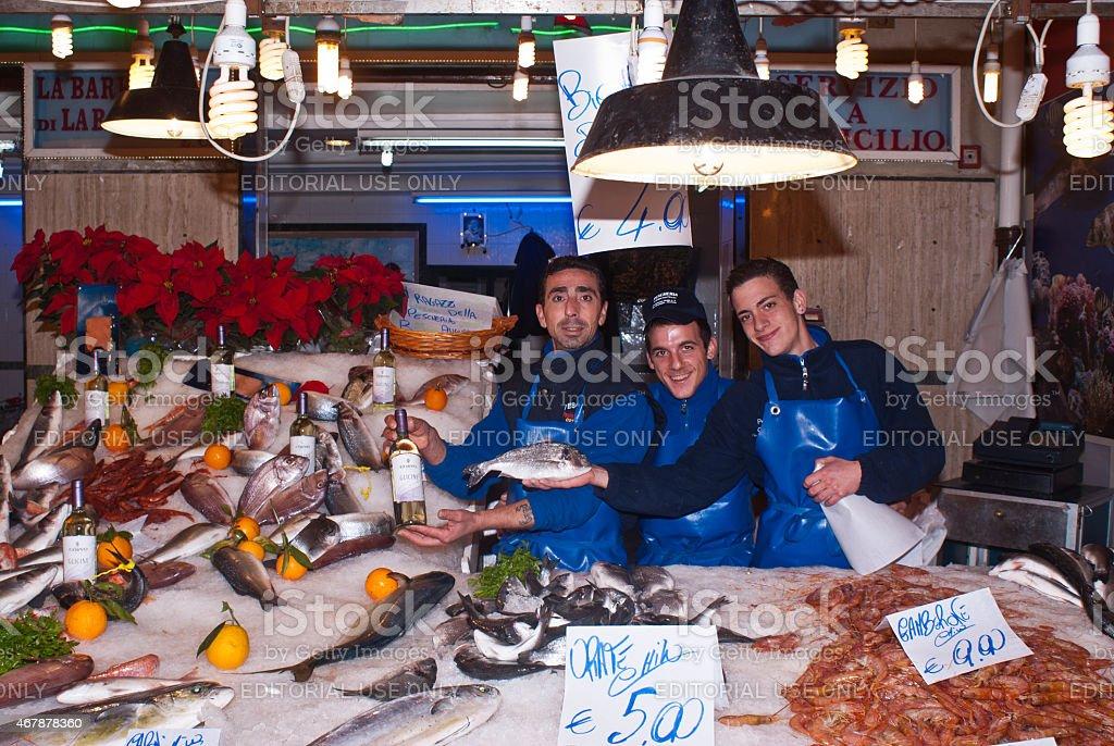 men selling fish stock photo