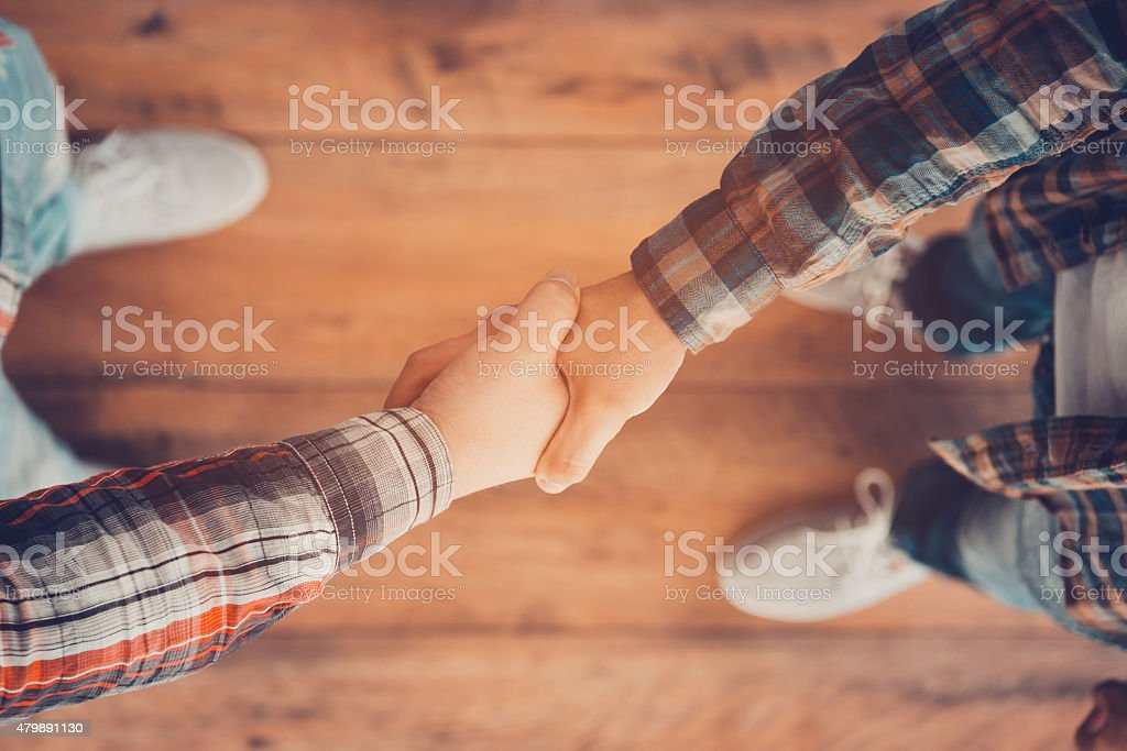 Men shaking hands. stock photo