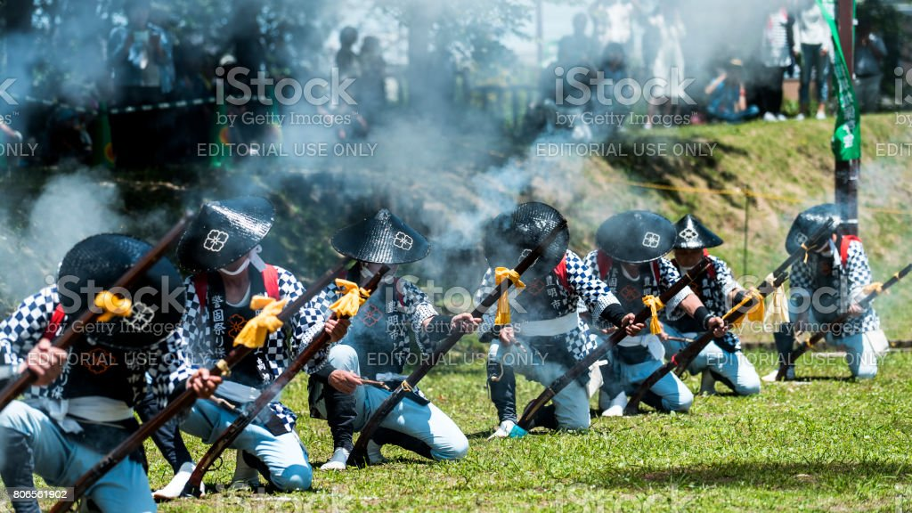 Men shooting antique gun for a traditional festival in Japan stock photo