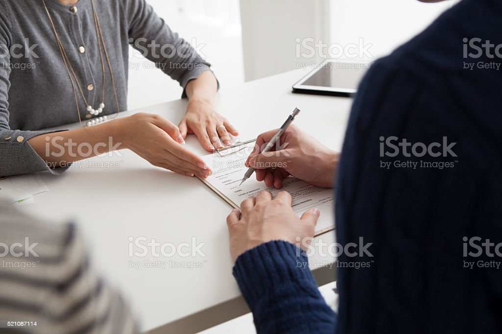 Men sign the new home of the contract stock photo