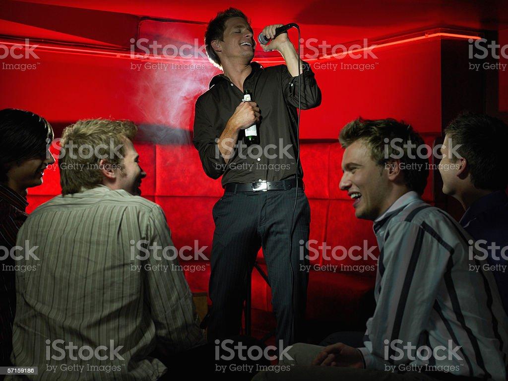 Men singing in a bar stock photo