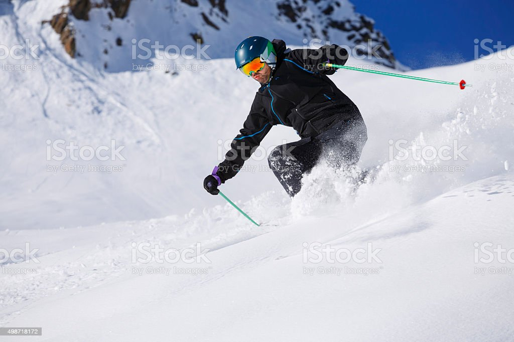 Men skier off piste skiing powder snow   Sunny ski resorts stock photo