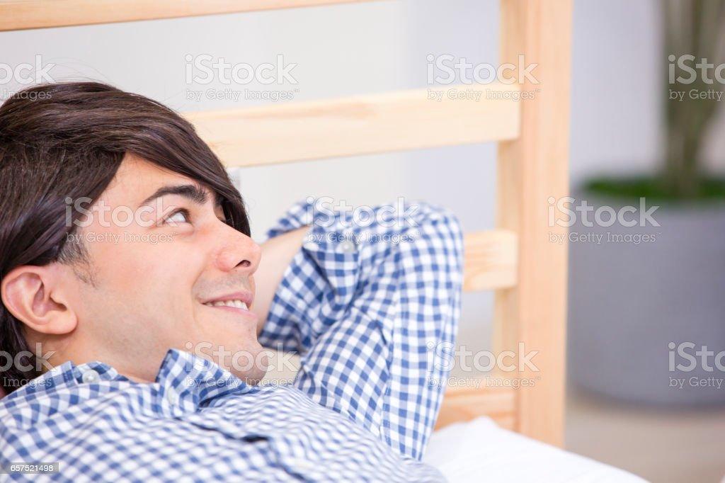 Men sleep in the bed stock photo