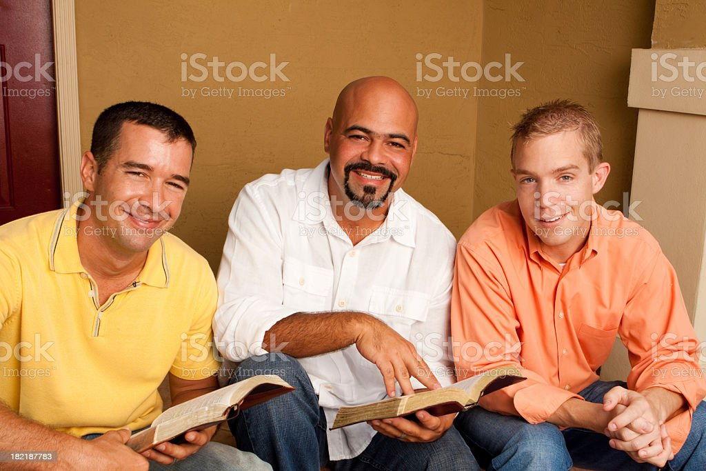 Men Smiling and Reading royalty-free stock photo