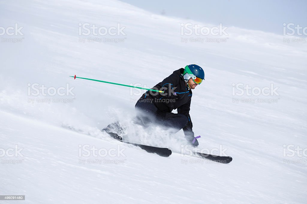 Men snow skier  skiing carving techniques at high speed stock photo