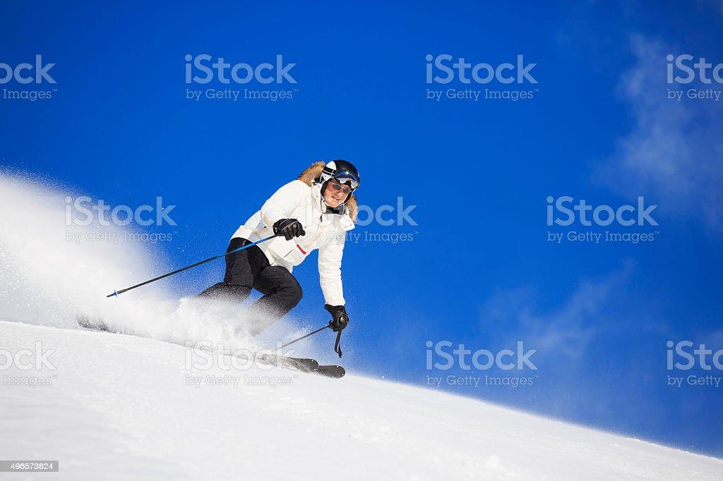Men snow skier skiing enjoying on perfectly prepared ski slope stock photo