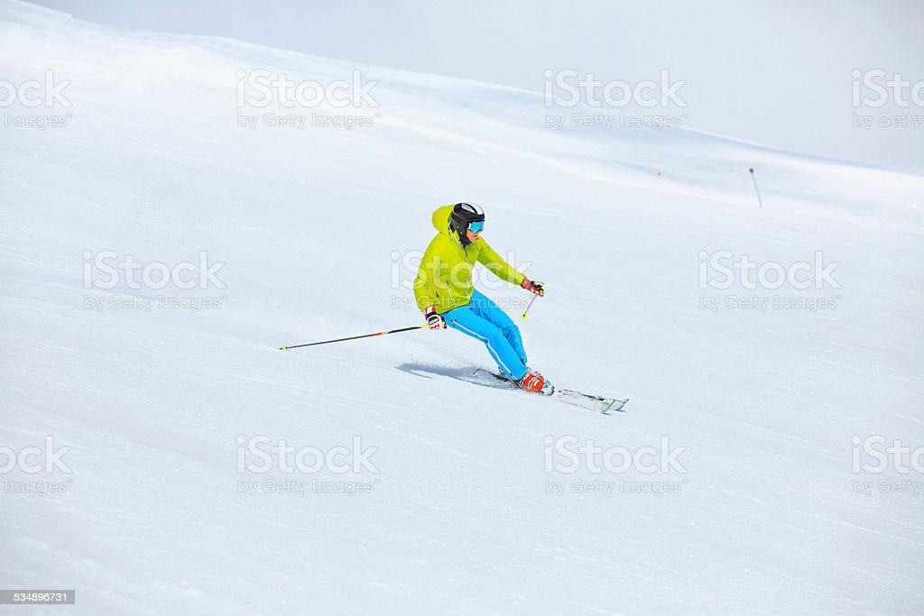 Vital mature men snow skier, equipped with modern carving ski...