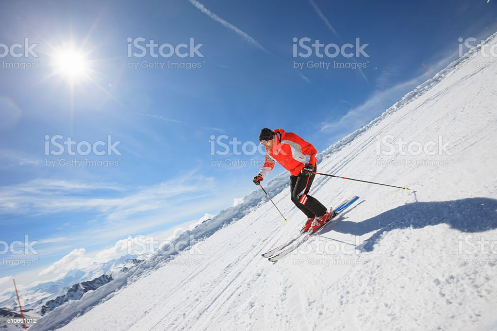 Men snow skier skiing on sunny ski resorts stock photo