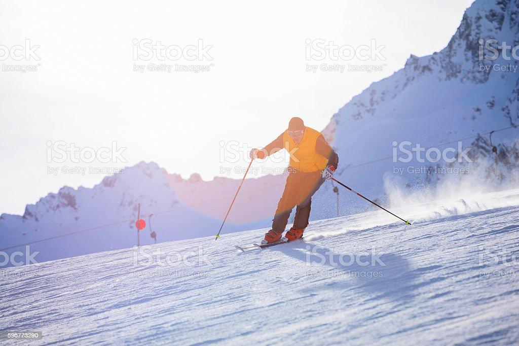 Men snow skier skiing on sunny ski resorts stock photo