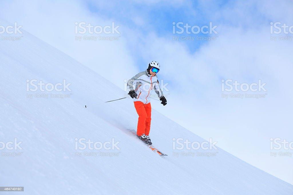 Vital senior men snow skier, equipped with modern carving ski...