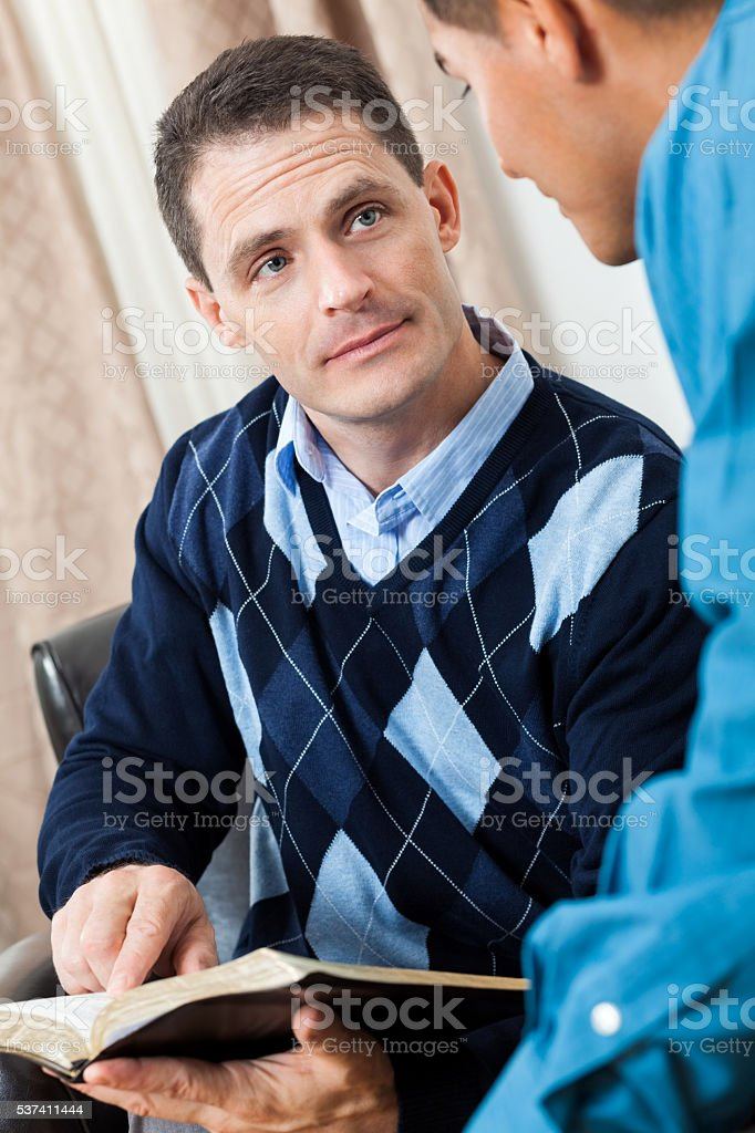 Men study the Bible together stock photo