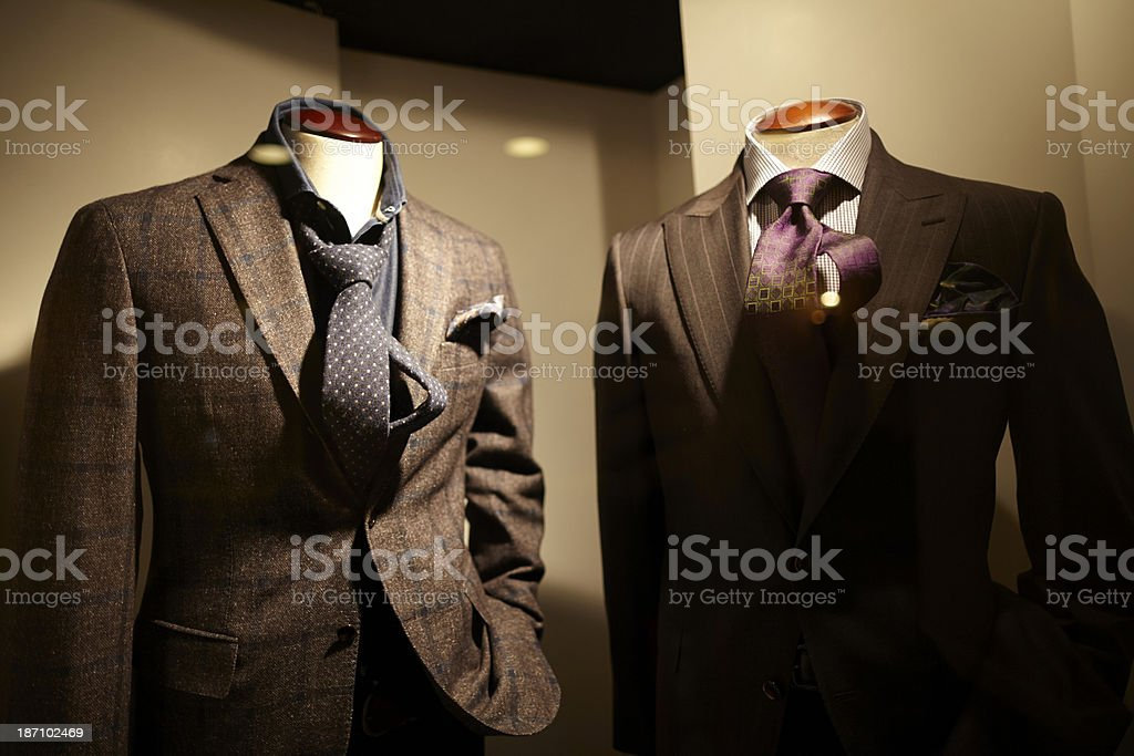 Men suits on display at a store royalty-free stock photo