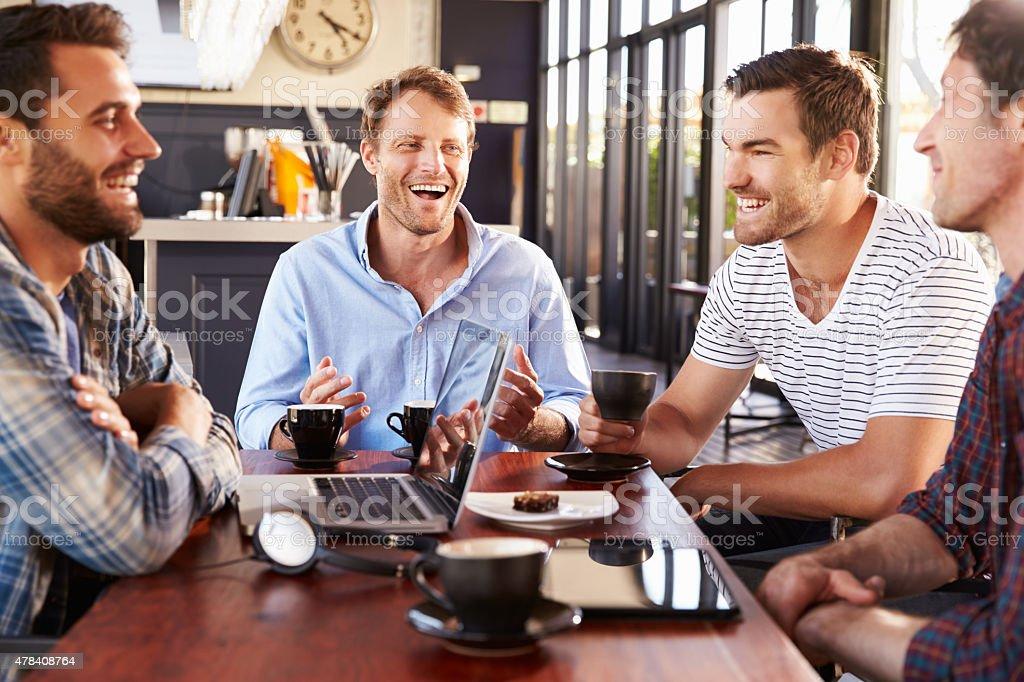 Men talking at a coffee shop stock photo