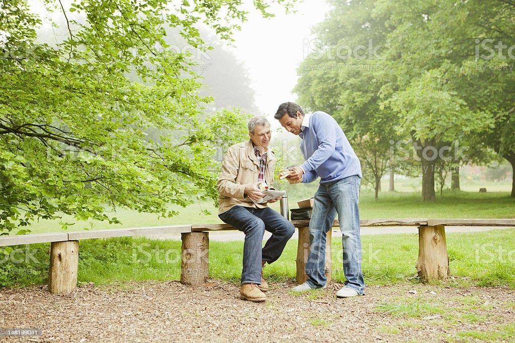 Men talking in park stock photo