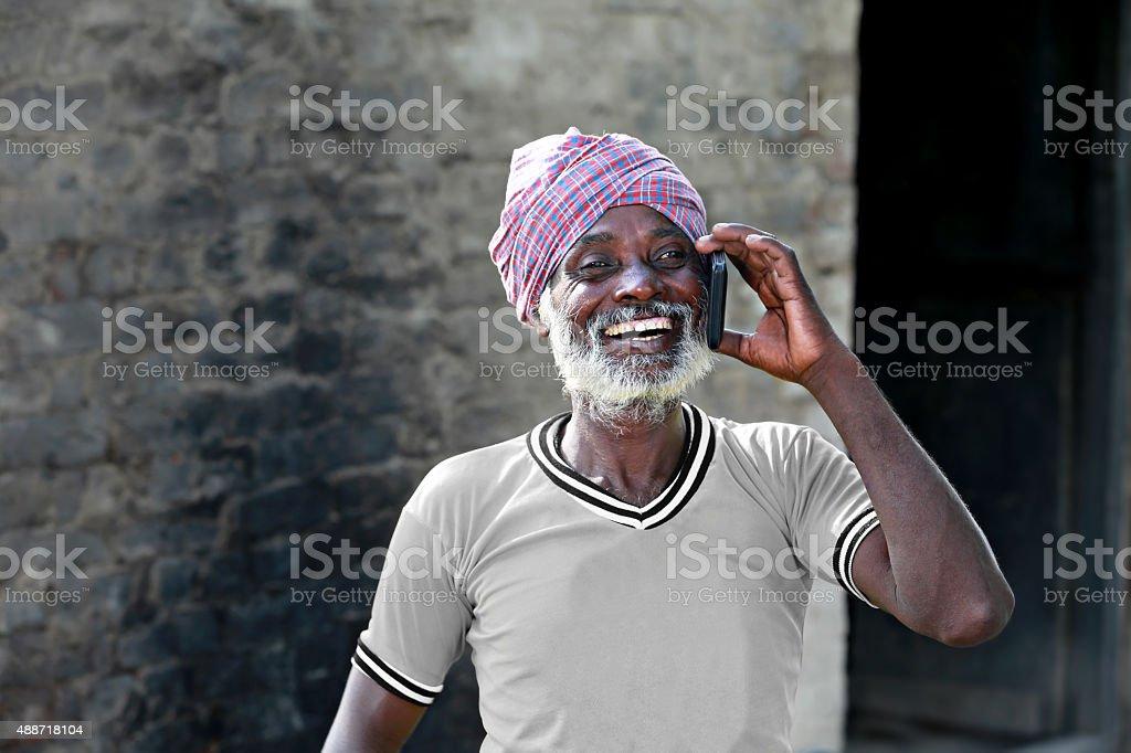 Men talking on Smartphone stock photo