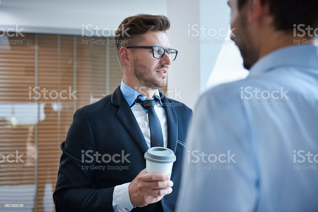 Men talking over a cup of coffee stock photo