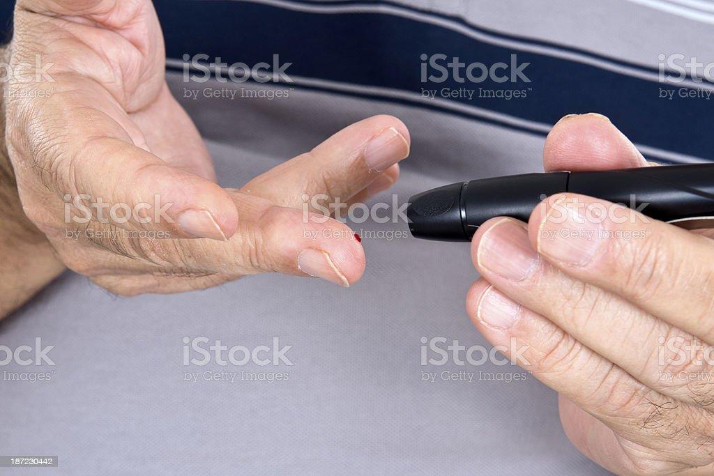 Men Tests Blood Sugar royalty-free stock photo