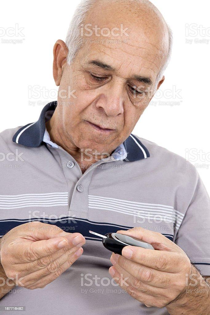 Men Tests Blood Sugar stock photo