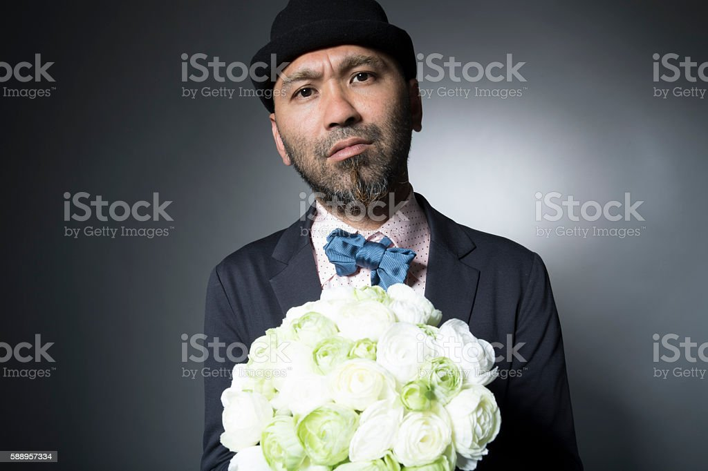 Men to propose with a bouquet of flowers stock photo