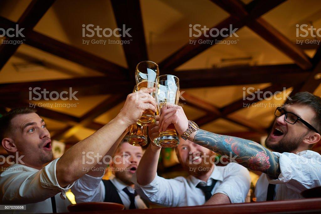 Men toasting stock photo