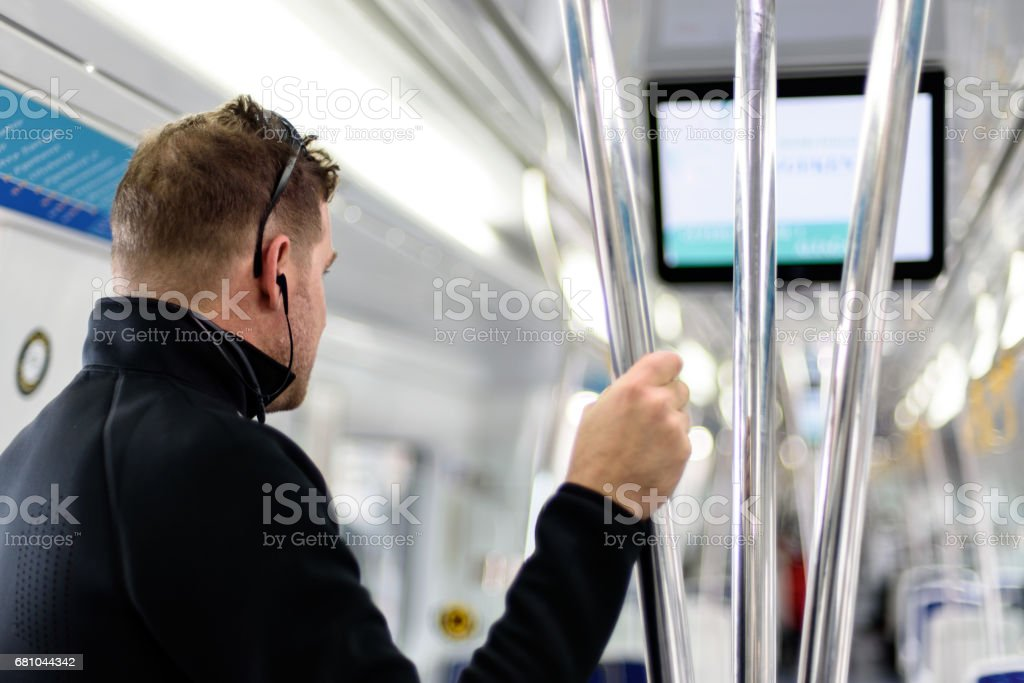 men traveling by train stock photo